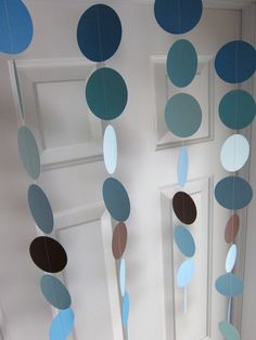 Paper Garland Decorations, Blue and Brown Circles, Baby Boy Shower. $18.00, via Etsy.