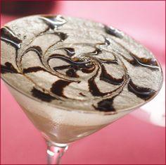 White Chocolate Raspberry Martini: 2 parts Vanilla Vodka, 1 part Chambord (Black Raspberry Liqueur), 1 part White Chocolate Liqueur, splash of heavy cream, and chocolate syrup. Yum!