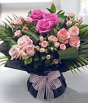Rose Classic. Various selection of pink roses with aspidestra and palm leaves...simply stunning!