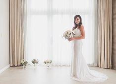 Bridal Portraits by floor to ceiling window.jpg