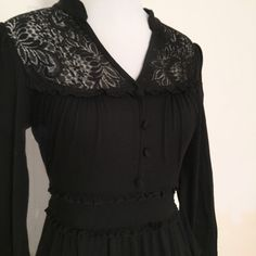 """Black collared button with lace dress ❗️❗️MAKE OFFERS!!! I am open to negotiations ! I also do SPECIAL bundle deals!   ➖CONDITION- EUC ➖SIZE- medium but I am a small and it fits me fine so -- see MEASUREMENTS ➖BRAND- Forever 21 ➖STYLE- Black dress with vintage styled neckline. The dress ties at the waist in the back.   ➖MEASUREMENTS       ➖Length: 37""""      ➖Bust: 15""""      ➖Waist: 13"""" (ties into the back) Forever 21 Dresses"""