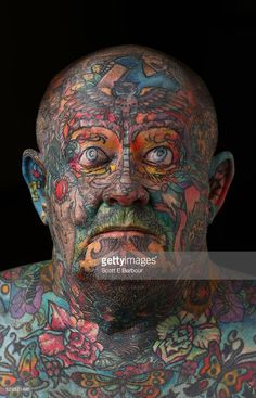 John Kenney poses for a portrait on April 28, 2016 in Melbourne, Australia. The 60 year old has tattoos all over his body, including his eyelids and eyeballs.