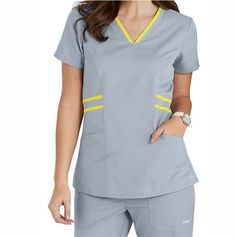 Striping detail at the waist and collar bring an upscale touch to this Grey's Anatomy Marquis top. Scrubs Outfit, Scrubs Uniform, Salon Wear, Landau Scrubs, Medical Uniforms, Hospital Uniforms, Greys Anatomy Scrubs, Medical Scrubs, African Men Fashion