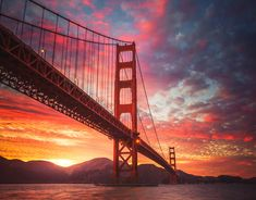 5 Things You May Not Know About the Golden Gate Bridge Tell me: What's this place everything about? This suspension bridge has been the defining landmark in San Francisco since it opened in It's not named for its shade (a color called… Best Sunset, Beautiful Sunset, Beautiful Places, Amazing Places, Overlays, Sunset Wallpaper, Golden Gate Bridge, Landscape Photography, Cool Pictures