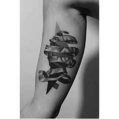 M. C. Escher inspired tattoo on the right inner arm.