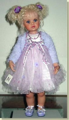 "TIFFANY ~ by Jan Mclean is from the  2002 Vinyl Collection    A lovely wee girl with a blonde mohair wig and violet eyes.    She is costumed in lavender tulle, sequin trimmed with cute eyelash fabric sweater, and on her feet she has lavender shoes to match.    She is fully poseable. Tiffany is a 22"" (56cm) tall doll with violet glasstic eyes and long lashes."