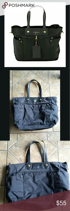 """Marc by Marc Jacobs Preppy Nylon Elizabeth Babybag Great used condition. Clean interior. Only real wear is on the handles slight fraying, see pics 4 & 5. Doesn't come with detachable strap, hangtag, or changing pad. Lots of pockets.  14"""" H x 20"""" W x 5"""" D. Price reflects all. Marc By Marc Jacobs Bags Baby Bags"""