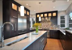 Modern Kitchen with trough sink, stainless appliances, clear story glass cabinets and Quartz counters. Kitchen Countertops, Kitchen Cabinets, Trough Sink, Glass Cabinets, Quartz Counter, Stainless Appliances, Beautiful Space, Basement, Kitchens