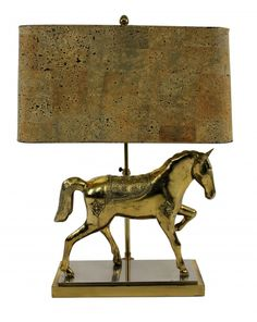 French gilt bronze table lamp in the form of a horse by Maison Jansen. Of good weight and quality and with its original faux cork shade.    C.1960'S