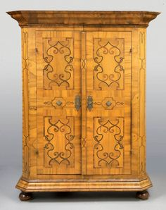 An Austrian armoire commode with multiple walnut inlays, circa 1800. From 2015 San Francisco Fall Antiques Show exhibitor, Vandeuren Galleries.