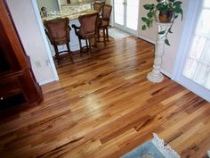 Triangulo Tigerwood Solid Flooring from Unique Wood Floors. Wood Floors Wide Plank, House, Faux Hardwood, Tigerwood Flooring, Installing Hardwood Floors, House Flooring, Flooring Materials, Bamboo Flooring, Engineered Hardwood Flooring