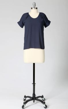 Sweet little blouse with ruffle detail on the raglan sleeve stitch. $24.75