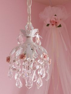 Shabby chic pendant chandelier - When I saw this, my mind went to a projects making use of recycled bottles, beads, flowers and ribbons.