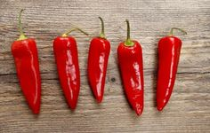 Red hot chili peppers on old wooden table - stock photo Spicy Recipes, Mexican Food Recipes, Food F, For Your Health, Health Benefits, Weight Loss, Stuffed Peppers, Stock Photos, Vegetables