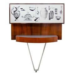 1950s Italian Fold Out Bar in the Manner of Fornasetti | From a unique collection of antique and modern dry bars at https://www.1stdibs.com/furniture/storage-case-pieces/dry-bars/