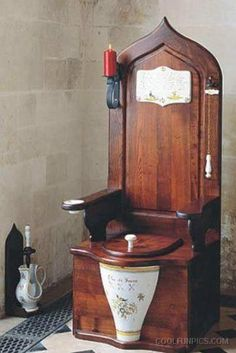 Queen Elizabeth I's Flushing Toilet, designed by one of her godsons, Sir John Harington in 1596. Harington introduced Queen Elizabeth I, and subsequently, the English, to the novelty of the the flushing toilet.