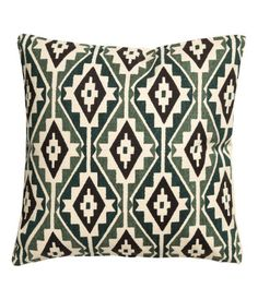 Natural white/moss green. Cushion cover in thick, woven cotton fabric with a printed patter at front and solid color at back. Concealed zip at lower edge.