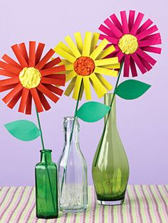 Bright Painted Flowers made from cut cardboard tubes. Great spring craft idea for kids.