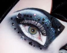 These ayes look very large and a little googly. I love the colours and the bold use of eyebrows with the subtle gems.