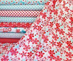 More pretty fabrics.  I love the flowers across the front, but the owl print is cute, too.
