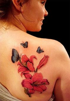Red flower and blue butterfly tattoo on back #tattoo #tattoos #ink