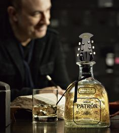 Packaging of the World: Creative Package Design Archive and Gallery: Patrón Añejo Holiday 2012 Guitar Bottle Stopper
