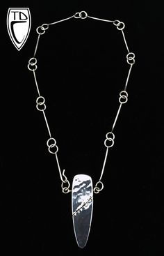 """Todd Conover Hollow Formed """"Torn"""" Pendant and Chain, 2014, sterling silver"""