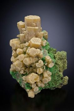 Mimetite on Bayldonite.  Tsumeb, Namibia. Mimetite is a lead mineral/ Bayldonite (green) is a copper mineral.