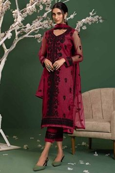 Be the cynosure of all eyes by wearing this ruby pink net trouser suit which will surely tell them that the diamonds aren't the only beautiful thing which they have seen. This v neck and full sleeve party wear suit highlighted with thread, stone and sequins work. Teamed up with santoon trouser pants in ruby pink color with ruby pink net dupatta. Trouser pants has thread work. #trousersuit #salwarkameez #malaysia #Indianwear #Indiandresses #andaazfashion