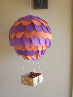 Hot Air Ballon Paper Lantern 10 inch for parties by CreateItGirl.   It can be used for nursery decor or parties. Use them to add great detail to your special occasion. Use the box (basket) to put candy, favors, cards or any other lightweight item. You choose the tissue paper color of ur preference.    Can be made in any color of your choice.