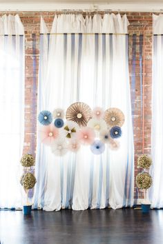 Modern paper floral backdrop: http://www.stylemepretty.com/texas-weddings/houston/2016/01/05/whimscial-texas-firehouse-wedding/ | Photography: Dana Fernandez - http://www.danafernandezphotography.com/