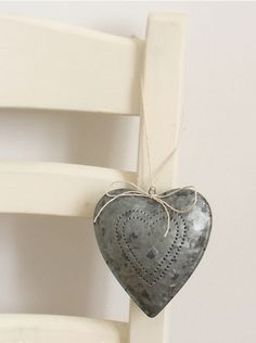 Love this tin-punch heart.... rustic beauty!