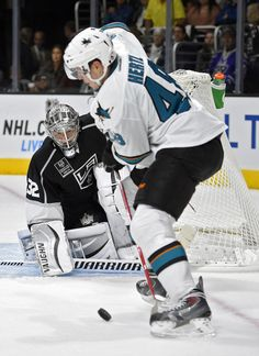 San Jose Sharks forward Tomas Hertl looks to settle a bouncing puck for a shot on goal (Oct. 8, 2014)