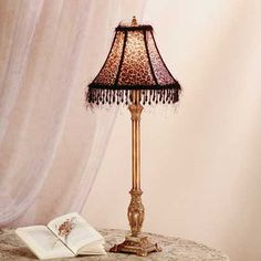Exotic cheetah print always goes with everything bejeweled animal buffet lamp with leopard print shade aloadofball Image collections