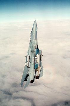 Jet climbing through clouds