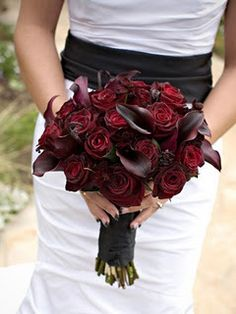 The deep, dark, rich color reminds me of my bouquet when I got married.  Except mine was only roses.  I love the contrast w/ a white dress.
