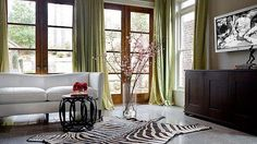 Drapes - not the color, but the height and material that doesn't seem heavy.  Doesn't crowd the windows.