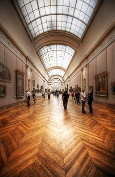 The Louvre has one hallway leading to another in an endless and awesome labyrinth of confusion. Maybe the most confusing thing is that there don't seem to be consistent floors.  - Paris, France - Photo from #treyratcliff Trey Ratcliff at http://www.StuckInCustoms.com