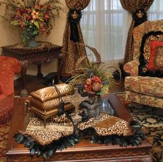 This leopard chenille Luxury Home Decor Table Runner accented with feathers and eyelash trim is one of my favorites. It looks great with just about everything! By Reilly-Chance Collection