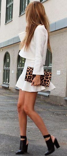 White flutter skirt + black heels.