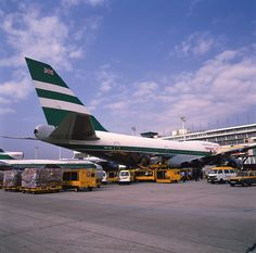 Kai Tak Memories.  Cathay Pacific B747 being loaded with cargo.