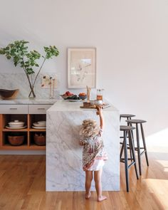Marble Trend For Food Photography - waterfall countertop on Kitchen cabinets and islands. Love it!!