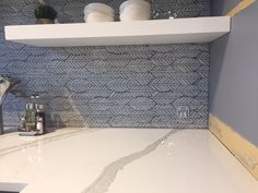 Artistic Tile I Our Leaf jazz glass pattern was installed as a backsplash in Dark Grey grout and we're loving the contrast effect! This beautiful #modern #kitchen was designed by Kara Levine of Decorative Materials Edwards location, along with Brandon Aug