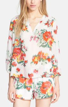 Excited to wear this sweet and sassy floral silk blouse on vacation this summer.