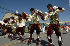 Caporales Dancers during the Urkupiña Festival in Cochabamba, Bolivia (©photocoen)