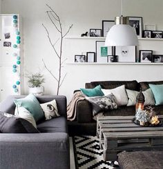 Mix and match cushions in the same colour palette for fail proof design #homedesign #cushions #exposedbrick #grey #teal #livingroom #couch by paperandwish http://discoverdmci.com