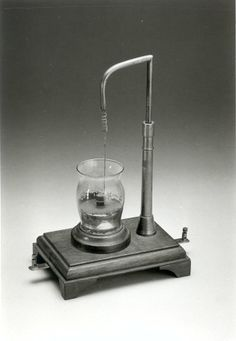 Michael Faraday's rotator, 1822, a device that rotates the polarization of light, demonstrating magneto-optic effects.