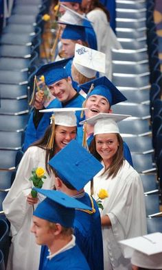 Graduates sporting huge smiles at the Norwell High School graduation ceremony on Saturday, June 2, 2012. Gary Higgins/The Patriot Ledger