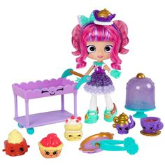 You're invited to the tastiest Tea Party in town! Tippy Teapot is serving up a trolley full of treats. You'll adore what she pours from her pretty teapot, and love her Shopkins display on her super cute tea cart! Tippy is as sweet as can be, just like her tea! Tippy's Tea Party with exclusive Shopkins is only available at Toys R Us. The set includes the Tippy Teapot Shoppie, 5 exclusive Shopkins, a trolley, pair of tongs, a cake stand, a doll stand, and VIP party pass.