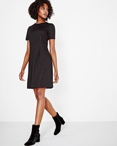 """The fitted bodice, slightly flared skirt and dotted jacquard fabric give this short sleeve dress just the right amount of sophistication for a head-turning exit.<br /><br />- Short sleeve<br />- Crew neck<br />- Invisible center back zipper<br />- 37.5'' length<br />- Our model wears a size small and is 178cm/5'10"""" tall"""
